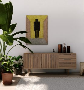 A bright living room with art hung above a cabinet