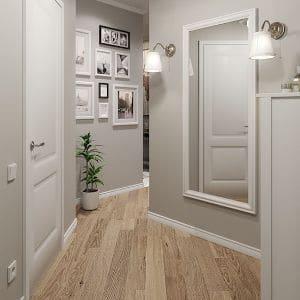 a gray hallway with wood floor