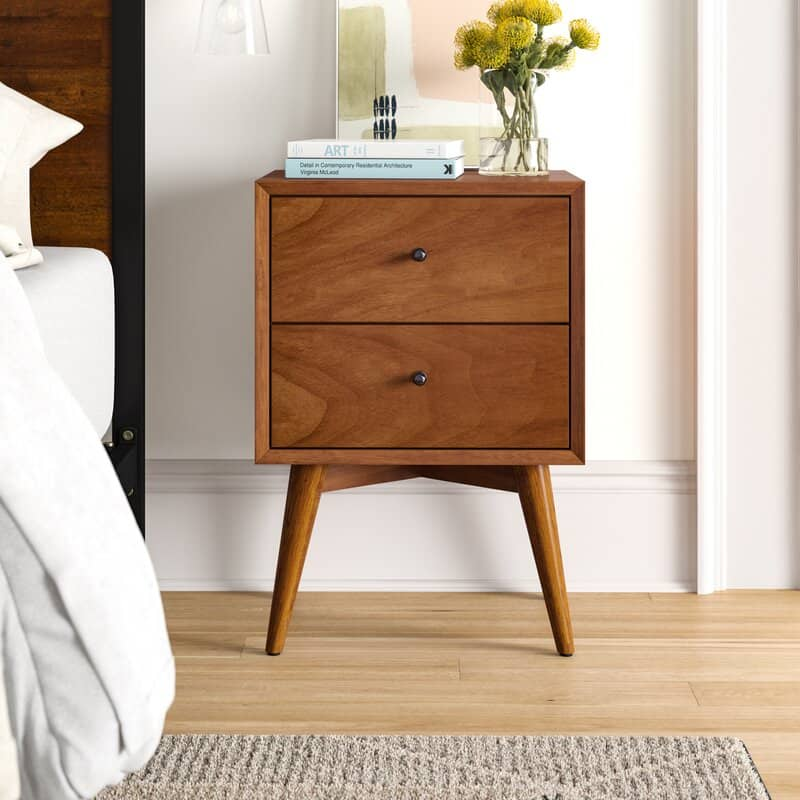 a wooden nightstand and two drawers in mid-century modern style