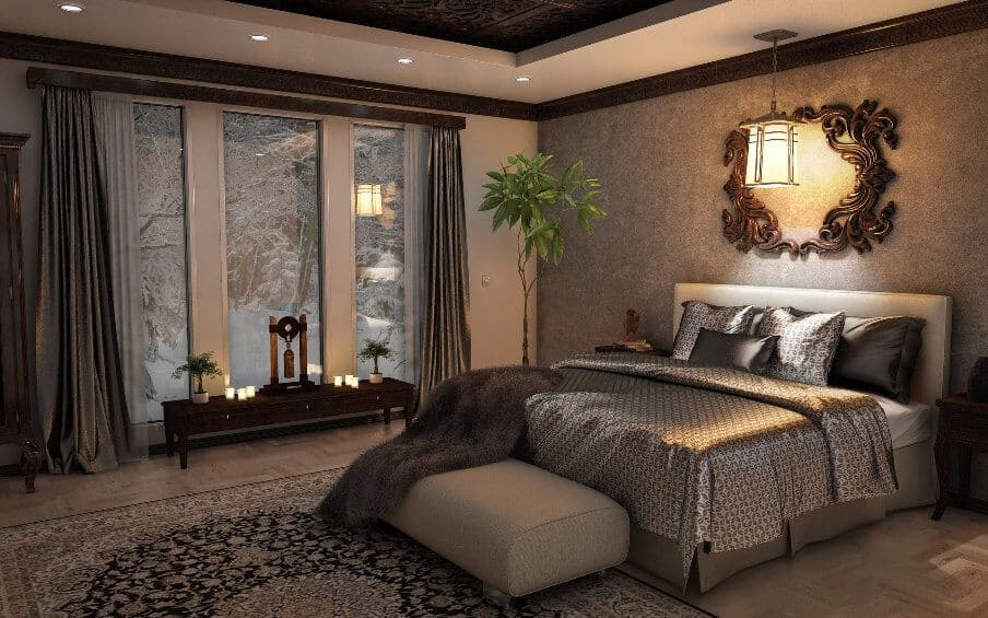 ornate looking bedroom setting with area rug in front in rich color scheme