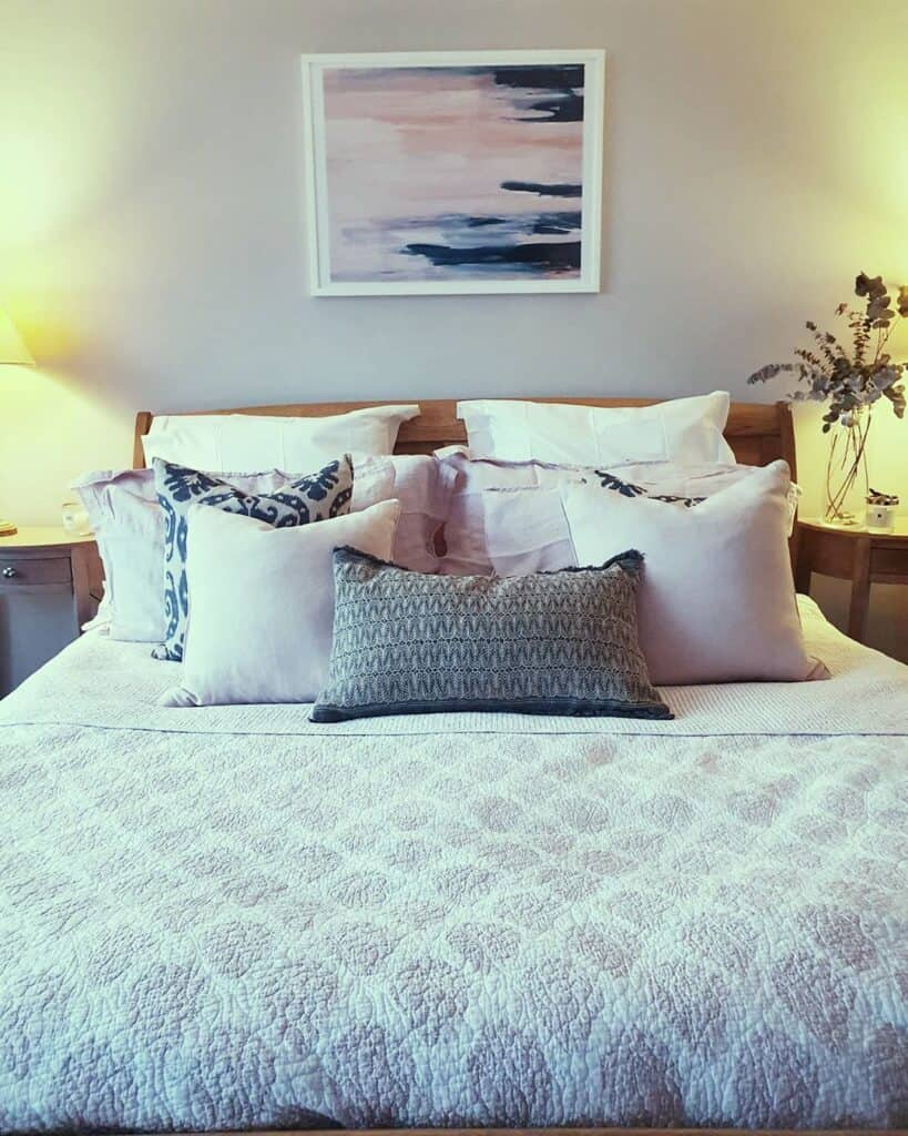 Edwardian bedroom with throw pillows
