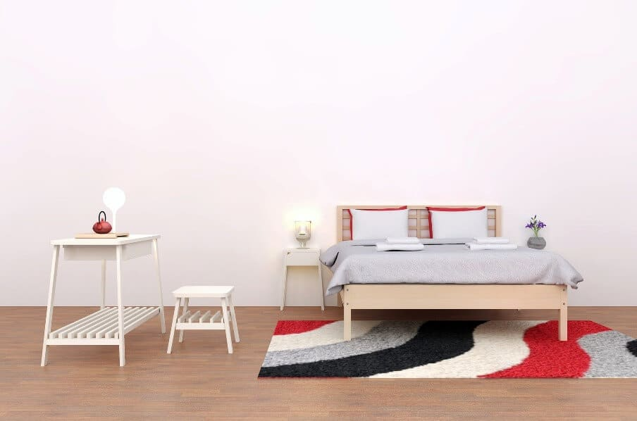 bed and side table sitting on an area rug with bold colors