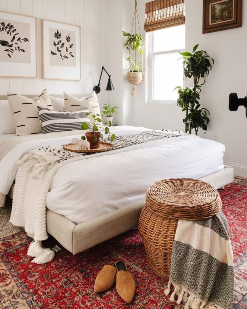 White bedroom with rug and wicker basket