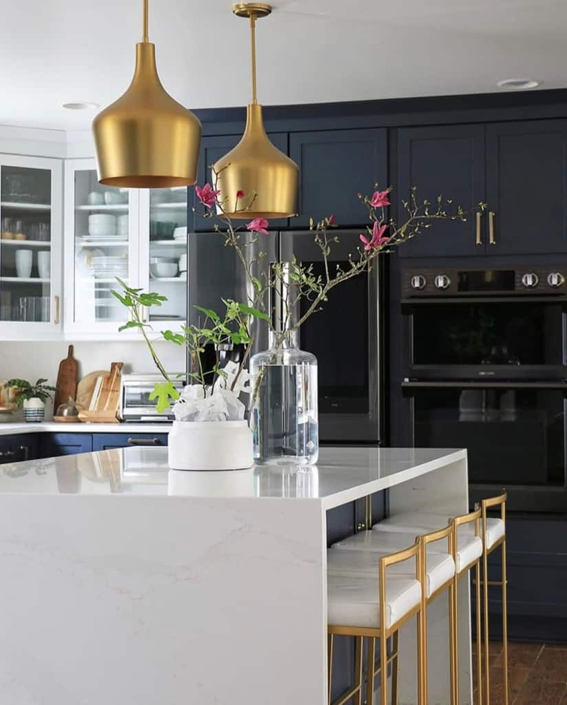 Dark kitchen with gold pendant lights
