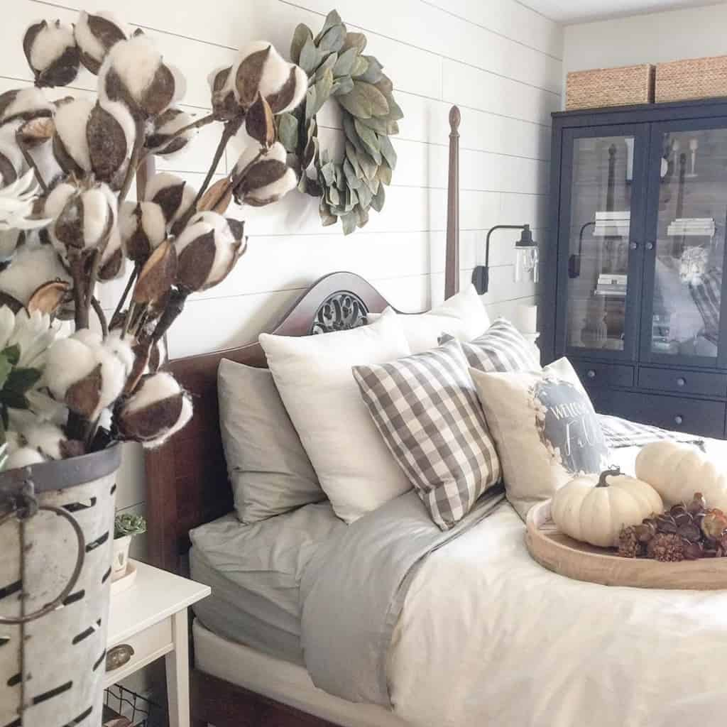 Farmhouse bedroom with throw pillows