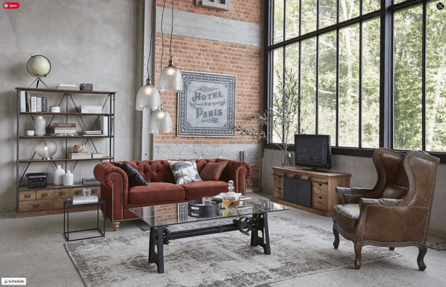 galss and metal coffee table in an industrial living room setting