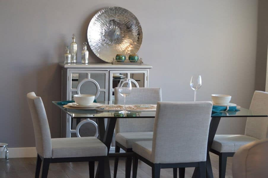 dining table setting with glass top table