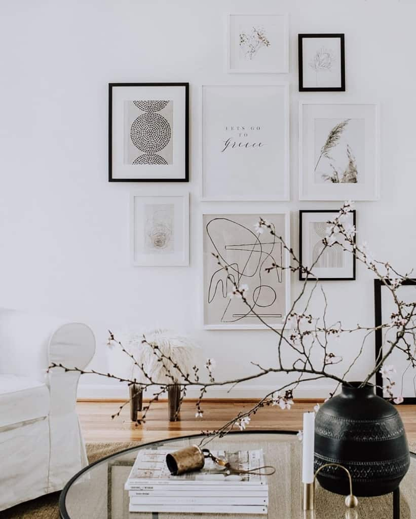 White living room with artwork and coffee table