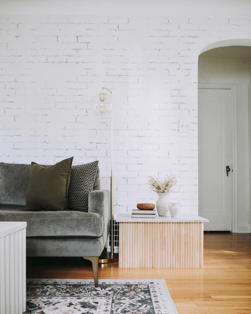 white walls and brickwork in living room and sofa
